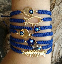 Items similar to gold fishbone/fish/flower/evil eye/star/ macrame bracelet on Etsy Bracelet Crafts, Macrame Bracelets, Jewelry Crafts, Handmade Wire Jewelry, Macrame Jewelry, Marine Style, Beaded Anklets, Layered Jewelry, Homemade Jewelry
