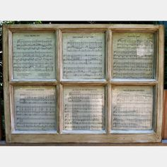 old windows/sheet music  Perhaps with Hallelujah Chorus music sheets for Christmas? Add greenery and bows?