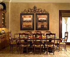 I want to do a portrait wall in hallway with same frames with wrought iron detail above a group of the same size frames :)