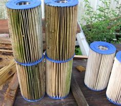 How to clean pool/hot tub filters.  Dirty filters on left, and cleaned filters on right, drying in the sun.