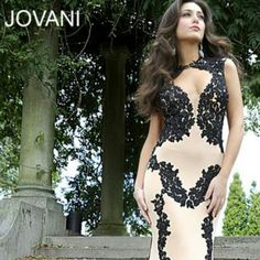 Jovani Prom Dress Black laced and Beige Jovani Gown that was worn once for an occasion.  Some cleavage in the front, low cut and backless. Beautiful dress and I absolutely love the material, super comfortable. Jovani Dresses