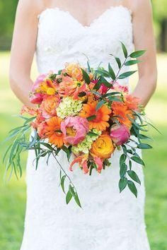 Bright tropical summer wedding bouquet | Alina Thomas Photography via Hill City Bride | See more: http://theweddingplaybook.com/top-wedding-bloggers-love/