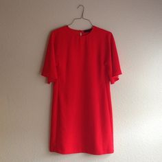Gorgeous vibrant red Zara cape dress size s Worn once for a Christmas party. Almost like new! This unique shift dress has a straight body and cape sleeves for a romantic but modern look. Small keyhole in the back with button closure. Fits a size s and possibly medium. Make an offer! Zara Dresses
