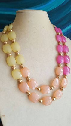 Check out this item in my Etsy shop https://www.etsy.com/listing/485113669/multi-strand-acrylic-bead-statement