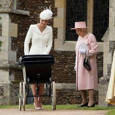 Three generations of the royal family – Queen Elizabeth, Duchess Kate and little Princess Charlotte in the monarch's vintage pram – at the little Princess' 2015 christening at the Church of St Mary Magdalene in Sandringham, Norfolk.