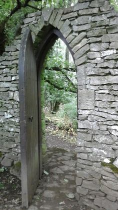 If you go through this door, you've already seen (or missed!) The famous dog who used to be a tree at Forbidden Corner in North Yorkshire. Photo by Jo-An-Zo. Forbidden Corner, Famous Dogs, North Yorkshire, Arch, Outdoor Structures, Garden, Holiday, Longbow, Garten
