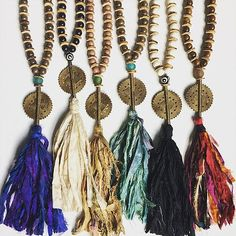 These beautiful statement pieces are upcycled sari silk fabric with baule brass pendants and wood/coconut beads. Yeah - you heard me! Available in Indigo, Ivory and Tan Tassel color combinations.