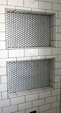 Contrasting tile niche with penny rounds