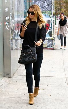 Love this casual look that LC rocks so easily. All black everything, finished off with tan ankle boots that are a winter essential this season.