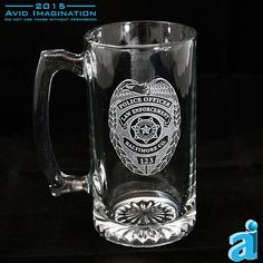 A Huge 27oz Glass Beer Stein with Handle and Starburst Bottom. This PD, Shield Stein is the perfect item for your favorite Officer. It makes a