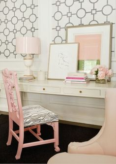 Tobi Fairley - living rooms - Annika Accent Lamp, Union Square Wallpaper, blush pink chair, white console desk, stacked books, framed figurative art, pink and green abstract art, geometric wallpaper <3