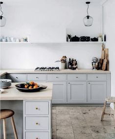 this gorgeous kitchen. from the home of Danish interior stylist Cille Grut. Image from Elle Decor Denmark, found via Classic Kitchen, New Kitchen, Kitchen Dining, Kitchen Decor, Kitchen Cabinets, Kitchen Art, Gray Cabinets, Minimal Kitchen, Stylish Kitchen