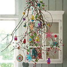Bundle of branches + ornaments. pinned with Pinvolve