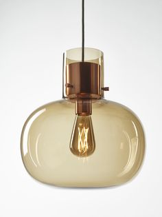 """A ball made from air wrapped in liquid is called """"Awa"""" in Japanese.This design sprung from the idea of creating lighting that looks like… Pendant Lamp, Pendant Lighting, Wood And Metal, Modern Lighting, Light Bulb, Perfume Bottles, Lights, Create, Glass"""