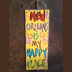 """""""New Orleans is My Happy Place"""" by Gabby Gumbo: Hand-painted with clear coat finish, *approximately 6x16 on 1/4"""" MDF, wire hanger for hanging. New Orleans artist Gabby Gumbo creates hand-painted funky"""