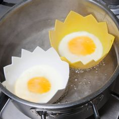 Pack of Two Silicone Egg Poachers-Price £4.99 Uses- Cook perfectly poached eggs. Ideal for Jellies, Ice Creams and Individual Desserts. Non Stick. Heat Resistant to 250c / 482F. Microwave, Oven, Freezer and Dishwasher Safe. #Kitchen, #Egg Accessories, #Preparation