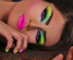 This fun neon makeup look is only for the bold! Match your nails to the look for some extra drama.