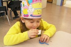 Kindergartener Aubrey Rampulla tests her sense of smell during her class lesson about the five senses. The students listened to different sounds such as a bell, whistle and clap; tasted different flavors, including sour lemon, hot and spicy cinnamon, sweet chocolate and salty pretzels; used their senses of sight and touch to observe rocks, leaves and twigs from the outdoors; and smelled the different scents of lotions, vanilla and shaving cream.