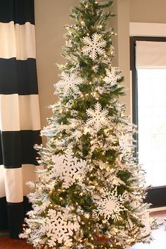 Snowflake tree`- Okay, so I might be a little obsessed with white for this holiday season!