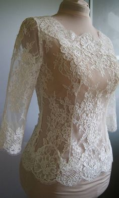 Beautiful wedding bolero. Amazing wedding bolero-top-jacket with lace. Color : 1. white 2. ivory Bolero made of lace. Lace is hand-cut . Bolero in front of a full, fastened at the back. Length below the waistline. Lenght sleeve -40 cm--16 inch ( possible longer sleeves) Made very