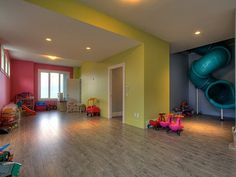 a slide that goes right from their bedroom to the playroom....how cool is that?