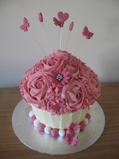 Giant Vanilla birthday white and pink butterfly Cupcake by Sadie's Cupcakes, via Flickr