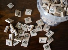 scrabble game for 50 cents at a yard sale and turned the letter tiles into tacks for my board! I put a dot of  E6000 glue on the back of each tile and attached a flat heat tack to each one.