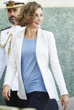 As well as her on-point uniform, Letizia ensured she looked elegant by styling her cropped light brown bob into glamorous waves