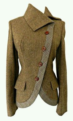 This jacket is cute. I like that it is fitted and defines the waist. I also like the collar and the mix of materials.