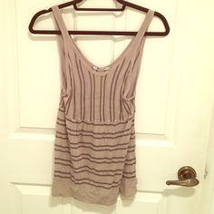 Alexander Wang tank top Alexander Wang striped tank top, pre-loved with a couple of very small holes as shown in 3rd photo. Low v neckline in the back of top also (4th photo) Alexander Wang Tops Tank Tops