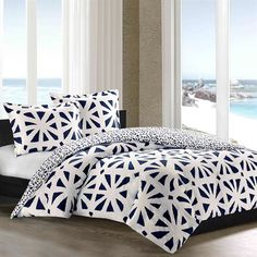 African Sun is a beautiful bed set brought to life with a bold sunburst pattern. The oversized duvet cover has a dark blue background to play up the bright white sunbursts. Made from 100% cotton sateen, this interesting set can be accessorized in countless ways.