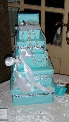 Tiffany & Co. Centerpieces Made to Order* custom made centerpieces Tiffany and Co themed Great for a bridal shower/baby shower/engagement party/sweet 16 Boxes wrapped *pearls(optional) *rhinestones (optional) Shipping varies upon quantity. Tiffany Blue Party, Tiffany Birthday Party, Tiffany Theme, 50th Birthday Party, Tiffany And Co, Tiffany Cakes, Breakfast At Tiffanys Party Ideas, Tiffany Breakfast, Eat Breakfast