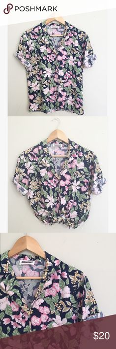"Vintage Floral Button Down Shirt This perfect lightweight shirt can be worn tied with high waisted shorts or with your favorite jeans. Rayon, Navy with pink floral pattern throughout. Matching skirt and blazer are also listed! 24"" long, 18"" pit to pit. Vintage size 6, fits like a M. Vintage Tops Button Down Shirts"