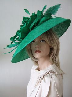 Peter Bettley Green Side Hat with Silk Flower, Twists and Ostrich Feathers from Dress-2-Impress Hat Hire