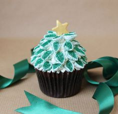 Christmas Tree Cupcakes. Cut mini-marshmallows diagonally and roll in edible glitter. Arrange. Post suggests gold foil cupcake wrappers.
