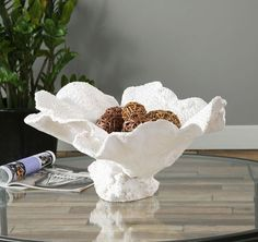 A beautiful example of faux coral can be found with this large off-white textured sealife inspired display bowl.  Add fall or holiday decor to make something special!