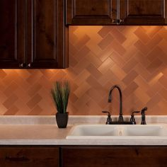 Aspect is a decorative metal tile that provides the look of custommetal backsplash and wall paneling at a fraction of the cost. Thiseasy to use product is available in four different colors and twogra
