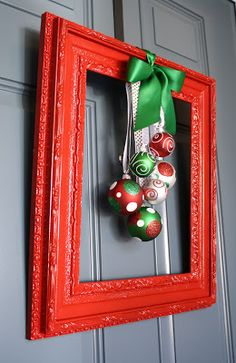 Framed Christmas Wreath - now this is a unique wreath that I could do with any thrift store frame and a little paint