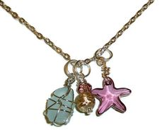 Silver Sea Glass & Starfish Necklace with Glass and Metallic Beads. Aqua Wire Wrapped Glass and Swarovski Starfish.