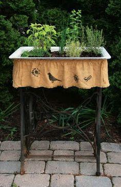 "Old sink & vintage sewing machine stand...great prim garden planter...love the crow ""skirt""."