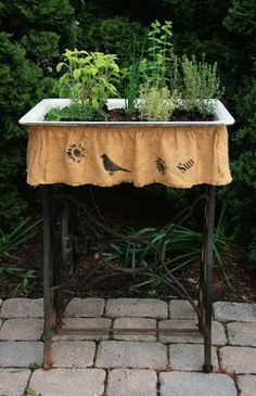 "Old sink & vintage sewing machine stand...great prim garden planter...love the crow ""skirt""."