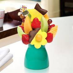 Delicious Daisy®  Dipped Pineapple  http://www.ediblearrangements.com/fruit-bouquet-detail.aspx?ArrangementID=95&t=1404351123514