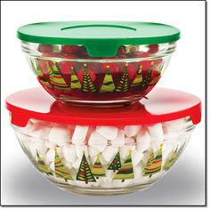 "Coming Campaign 23 Holiday Glass Serve & Store Set   These holiday-inspired glass bowls are perfect for serving and storing. Large, 6 3/4"" diam. x 3 1/8"" H. Small, 5 1/2"" diam. x 2 1/2"" H. Microwave- and dishwasher-safe. Glass with plastic lids. Imported.   Brochure:  $12.99 the set   available in my online store www.youravon.com/hslocomb  10/18/14"