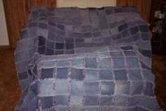About to finish two of these for the twins.   Thankfully these type of quilts cover up a multitude of sins from having arthritic hands.  They will cover a queen size bed and are made from jeans the boys have out grown through the years and the front is made of homespun material.  I think they will like them.