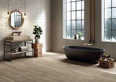 Pour une salle de bains chaleureuse at authentique, mettez une petite touche de bois ! Les revêtements de sol en grés cérame ont la côte et imitent parfaitement le bois avec un choix de nuances très varié. Besoin d'inspirations ?  Un projet d'aménagement ou de rénovation ? Contactez-nous!  #bois #wood #grescerame #salledebains #bains #bathroom #deco #design #interieur #maison #decoration #scandinave #nature #carrelage Traditional Interior, Contemporary Interior Design, 9 Mm, Round Design, Wall And Floor Tiles, How To Antique Wood, Clawfoot Bathtub, Porcelain Tile, Stoneware