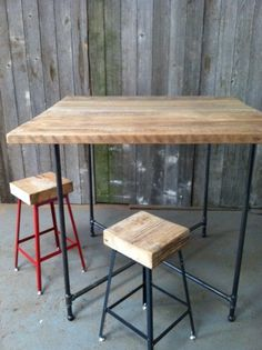 Industrial reclaimed wood Island and Bar Table (seats 8). $1,400.00, via Etsy.
