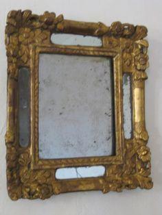 Miroir XVIIIème en bois doré et glaces au mercure