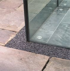 John McCall Architects, Private House. Glass box edging and drainage detail