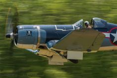 Vought F4U-4B Corsair just after takeoff.  Wheels coming up.