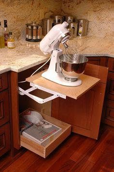 Remodeled kitchen with mixer stand and storage cabinet by Neal's Design Remodel.